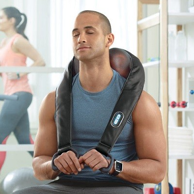 Brookstone Cordless Shiatsu Neck & Back Massager used in gym.
