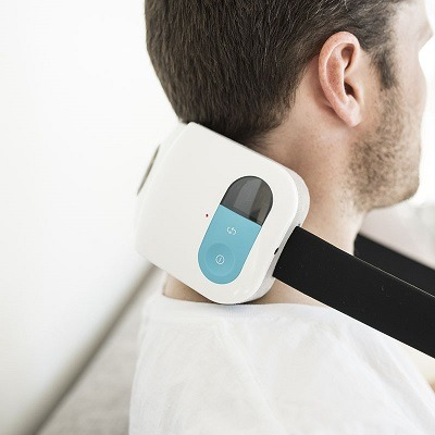Using a neck massager.