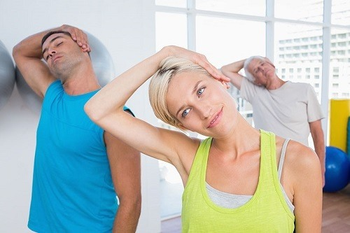 Group Of People Doing Neck Stretches